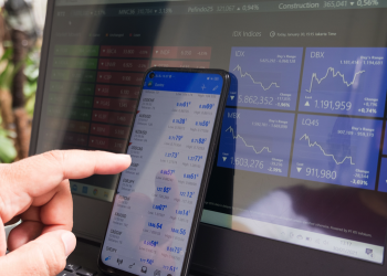 Forex trading using smartphones and laptops.
