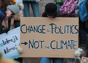 """Change the politics, not the climate!"""" A sign made by kids during the Friday's for future climate strike at the Helsinki Parliament in April 2019"""