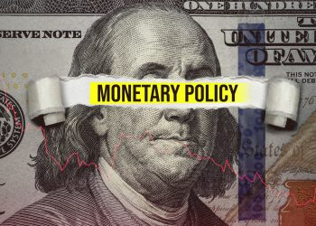 Torn bills revealing Monetary Policy words. Ideas for Increase or Decrease interest rates, Stimulate the economy, Moneyless valuable