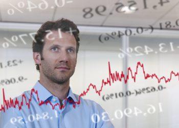 Businessman looking at financial market data