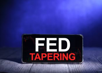 Taper Tantrum concept, global economic world market reacting to the Fed Tapering Off. Word text typography